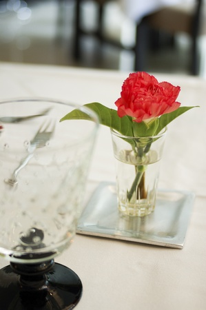 Dinning table set with red flower photo