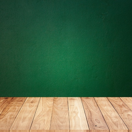 Green wall with wood plank floor texture background photo