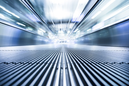Moving modern escalator way to success business Stock Photo
