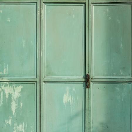 Green metal door background photo