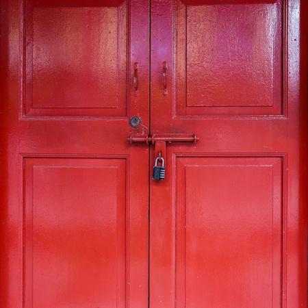 wooden door: Red door with lock