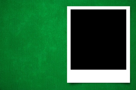 Photo frame on Green carpet background texture photo