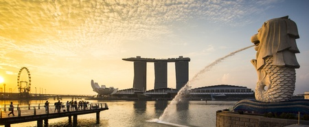 symbol tourism: Singapore landmark Merlion with sunrise Panorama