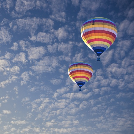 Hot air balloon on cloud photo