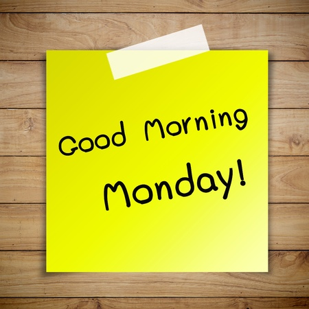 Good morning monday on sticky paper on Brown wood plank wall texture background photo
