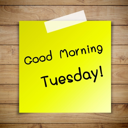 good morning: Good morning tuesday on sticky paper on Brown wood plank wall texture background