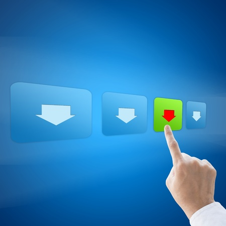 Hand press download button on blue background photo