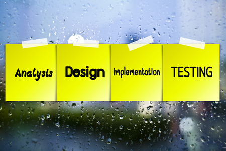 agile: Software process sticky paper on glass with drops water background