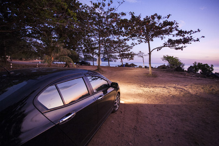 Car with sunset viewpoint photo