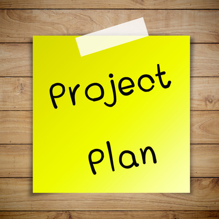 project planning: Project plan on sticky paper on Brown wood plank wall texture background Stock Photo