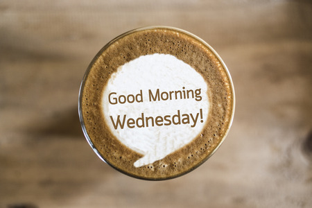 morning routine: Good Morning Wednesday on Coffee latte art concept Stock Photo