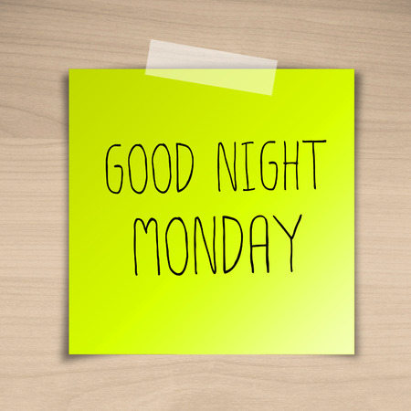 Good night monday sticky paper on brown wood background texture photo