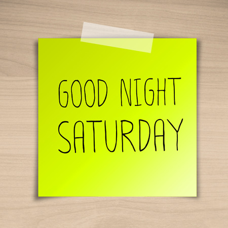 saturday: Good night saturday sticky paper on brown wood background texture