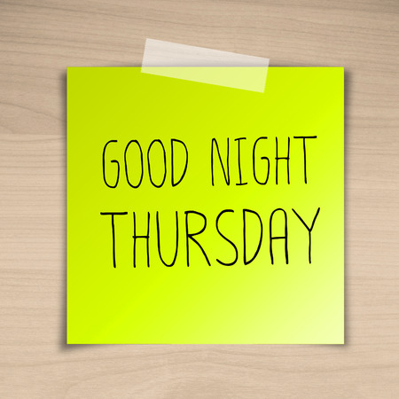 Good night thursday sticky paper on brown wood background texture photo