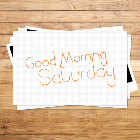 saturday: Good Morning Saturday on paper and Brown wood plank background Stock Photo