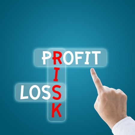 profitability: Business hand finger to profit risk loss Stock Photo
