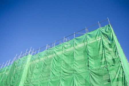 Green cloth cover on building construction site Stock Photo