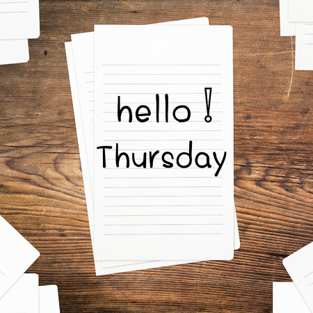 thursday: Hello Thursday on paper and wood table desk
