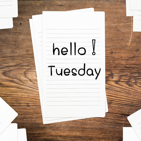 Hello Tuesday on paper and wood table desk