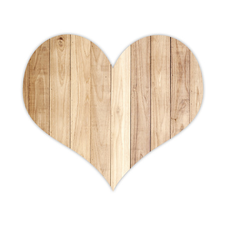 Wood heart shape isolated on white background photo