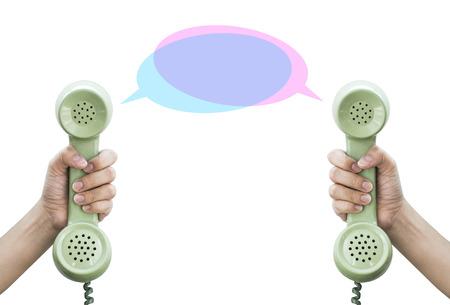 Communication  Hand hold retro telephone isolated on white background  photo