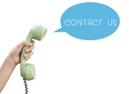 Contact Us  Hand hold vintage telephone isolated on white background photo