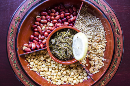 burmese: A selection of typical Myanmar snacks: tasty and spicy seeds, nuts and pickled tea leaves. Stock Photo