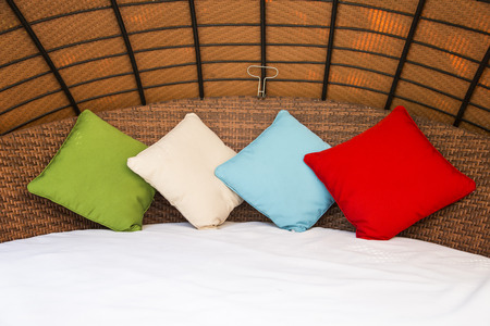Colorful Pillow on hotel bed with space for text photo
