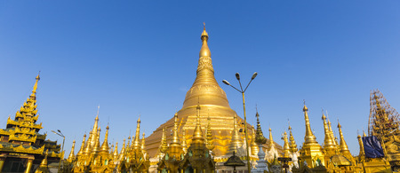 Panorama of Shwedagon pagoda with blue sky. Yangon. Myanmar or Burma. photo