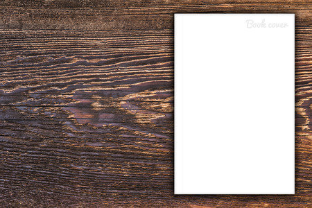 Blank book or magazine cover on wood background photo
