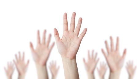 alzando la mano: Un líder de la mano con la mano detrás de desenfoque concepto de negocio Foto de archivo
