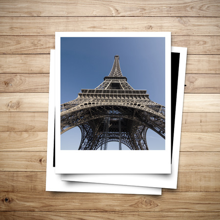 Eiffel Tower memory on photo frame brown wood plank background photo