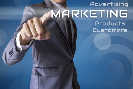 Businessman press Marketing of business conceptual photo