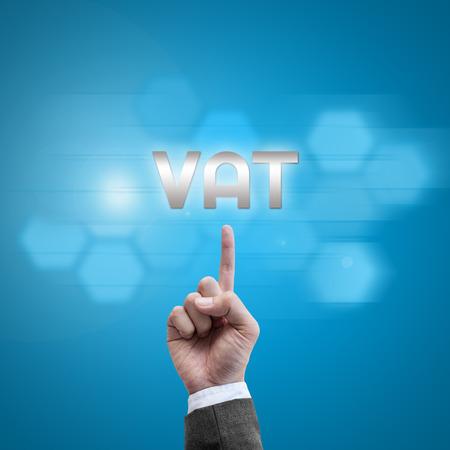 vat: Businessman hand working with modern computer interface as VAT concept