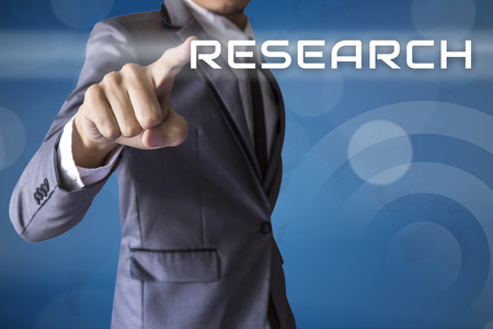 research study: Businessman touch Research conceptual Stock Photo
