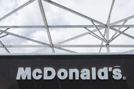 THAILAND - SEPTEMBER 04, 2014: McDonalds logo on sky background. It is the worlds largest fast food chain, over 31,000 restaurants worldwide, serve 58 million customers each day