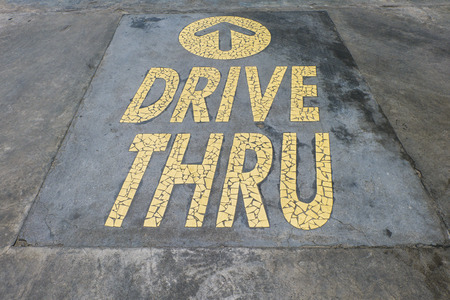 THAILAND - SEPTEMBER 04, 2014: McDonalds logo drive thru. It is the worlds largest fast food chain, over 31,000 restaurants worldwide, serve 58 million customers each day