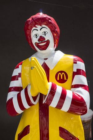 THAILAND - SEPTEMBER 04, 2014: Ronald McDonald character stand on black background at Mccafe Star Avenue.