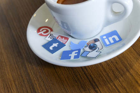 tumblr: CHIANG MAI, THAILAND - SEPTEMBER 24, 2014: Social media brands printed on sticker and placed on hot coffee cup morning life. Editorial