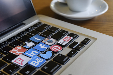 CHIANG MAI, THAILAND - SEPTEMBER 24, 2014: Social media brands printed on sticker and placed on keyboard Apple laptop.