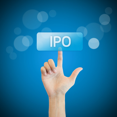 stock market launch: IPO. hand man pressing ipo button.