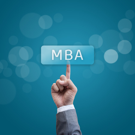mba: MBA. hand man pressing mba button.