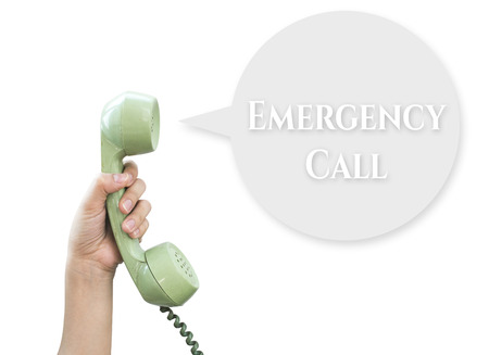 Emergency Call. Hand hold vintage telephone isolated on white background photo