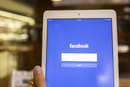 CHIANG MAI, THAILAND - SEPTEMBER 17, 2014: Facebook application sign in page on Apple iPad Air. Facebook is largest and most popular social networking site in the world. Editorial
