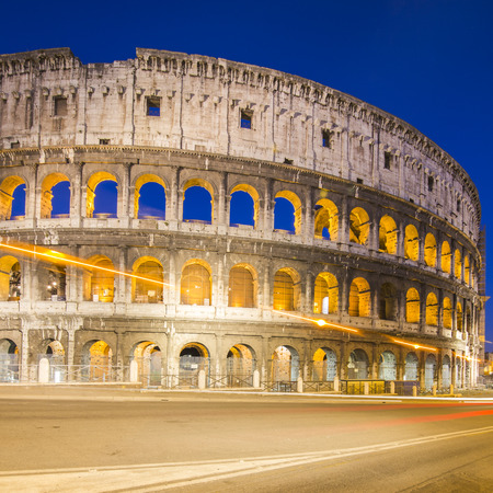 Colosseum in Rome with car lighting, Italy photo