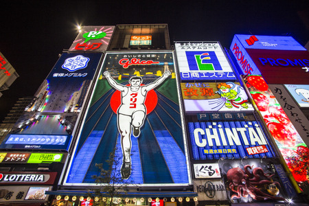 OSAKA, JAPAN - OCTOBER 28, 2013: The famed advertisements of Dotonbori. With a history reaching back to 1612, the districtis now one of Osakas primary tourist destinations.
