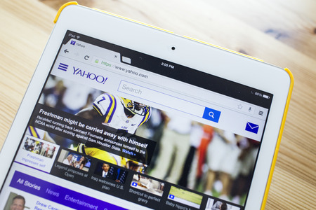 CHIANG MAI, THAILAND - SEPTEMBER 07, 2014: Yahoo.com website page using Apple iPad Air on September 7, 2014 in Chiang Mai, Thailand.