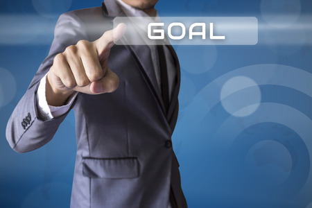 Businessman press Goal of business conceptual photo