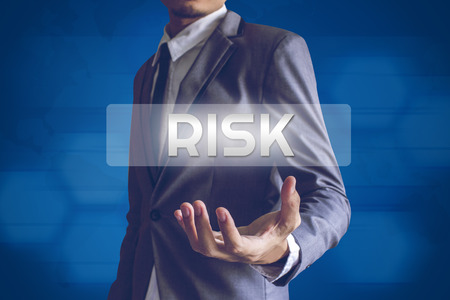 riskiness: Businessman or Salaryman with Risk text modern interface concept. Stock Photo
