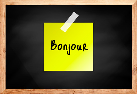bonjour: Bonjour on wood blackboard in black color Stock Photo